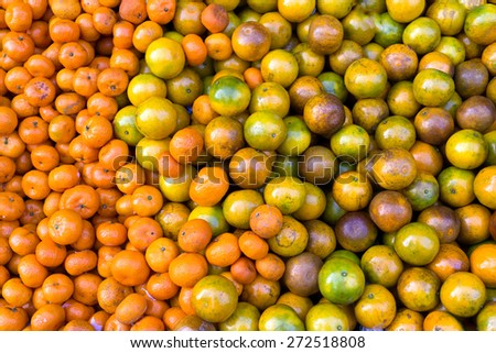 Background of oranges bunch in tropical market