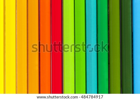 Background of parallel colorful pencils, close up