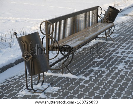 Background of park bench on the pavement slab quiet winter alley at snowfall Outside cold weather - stock photo