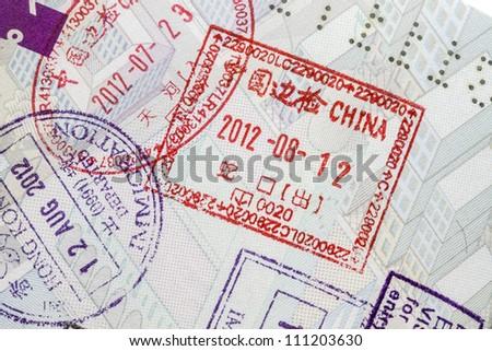 Background of passport stamps closeup - stock photo