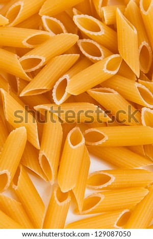 background of penne rigate pasta. italian food.