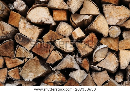 background of pile of wood logs - stock photo