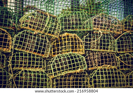 background of piled group of fishing cage traps  - stock photo