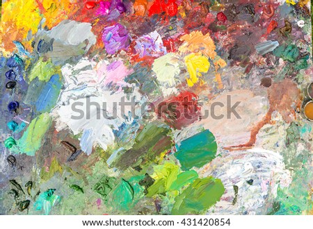 Background of professional painter's palette with fresh oil paint outdoors