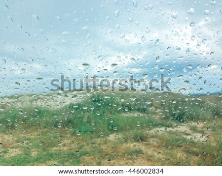 Background of rain drops on a window glass in a rainy day