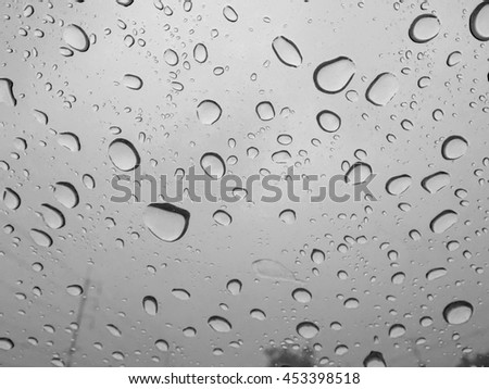 Background of Rain drops on windshield,image black and white.           - stock photo