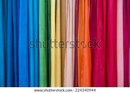 Background of rainbow color textile close up - stock photo