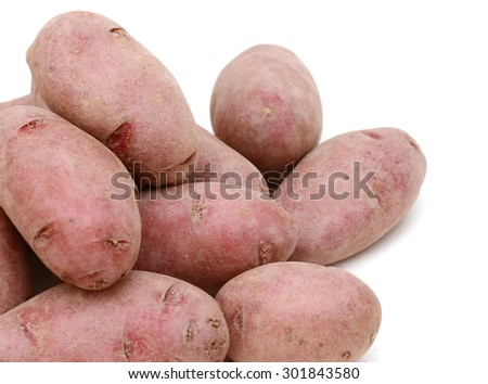 background of red fingerling potatoes isolated on white  - stock photo