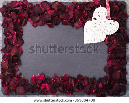 Background of red rose petals ,on a black background.Valentine's day.Copy space.selective focus.