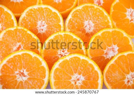 background of ripe and freshly sliced  tangerines