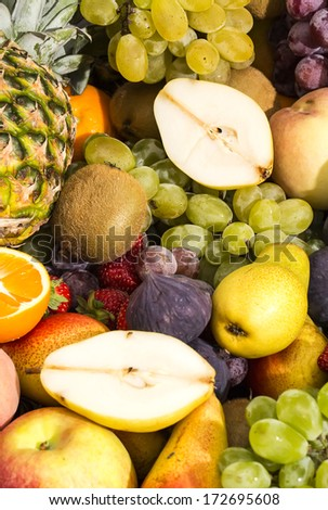 background of ripe fruit apples oranges grapes