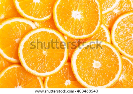 Background of ripe juicy orange slices, healthy food - stock photo