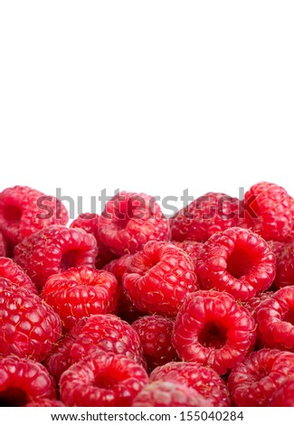 Background of ripe red raspberries. �?solated on white - stock photo