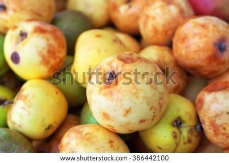 Background of ripe slightly spoiled colorful apples. Apples on the market - stock photo