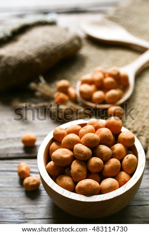 Background of roasted peanuts coated by salt and spicy