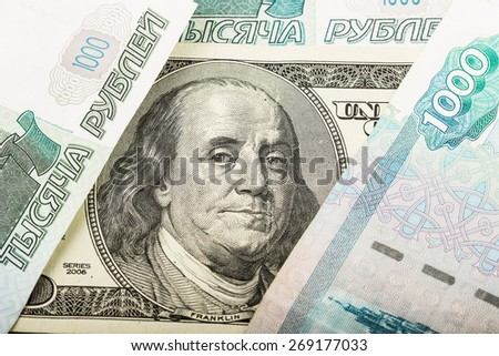 Background of Russian and American banknotes. concept