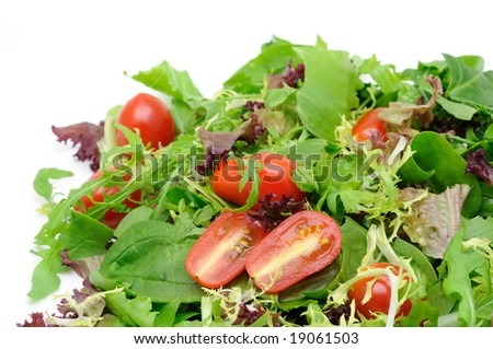 Background of salad leaves and cherry tomatoes with copyspace