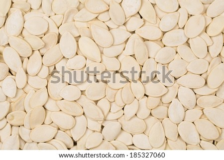 background of salted pumpkin seeds - stock photo