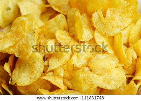 Background of salty potato chips - stock photo