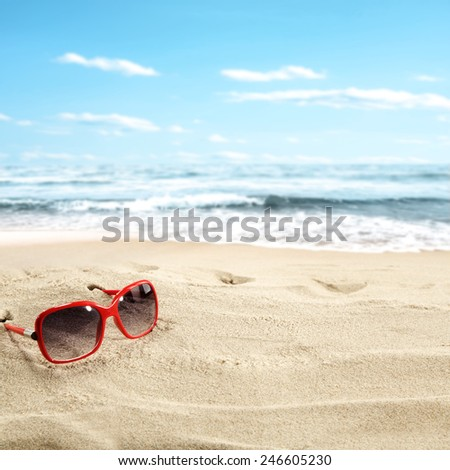 background of sand on the beach and glasses  - stock photo