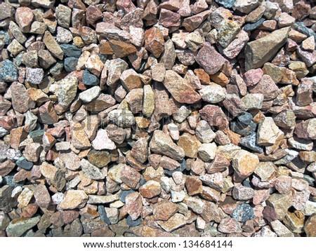 Background of small granite stones - stock photo
