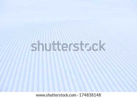 Background of snowcat track close-up - stock photo