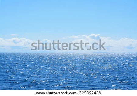 Background of sparkling sea water on a bright sunny day. Soft focus - stock photo