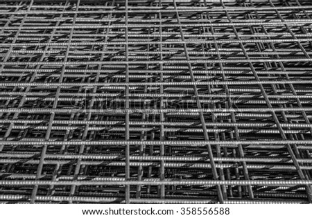 Background of squares on a heap of metallic fences.