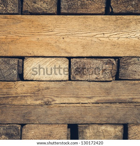 Background of Stacked Wood Cut in   Squared Timber - stock photo