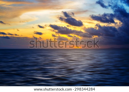 Background of sunset sky and cloud on sea - stock photo