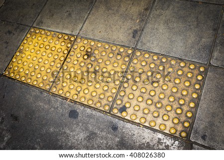 Background of Tactile paving for blind handicap on dirty grunge cement floor  - stock photo