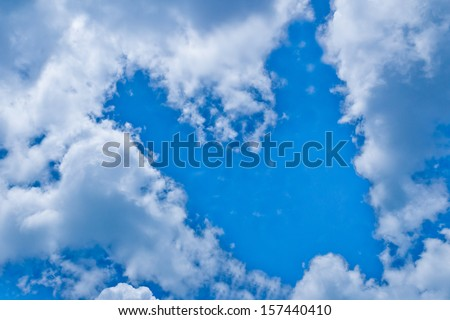 background of the blue sky with a white cloud in the form of heart. Love shape