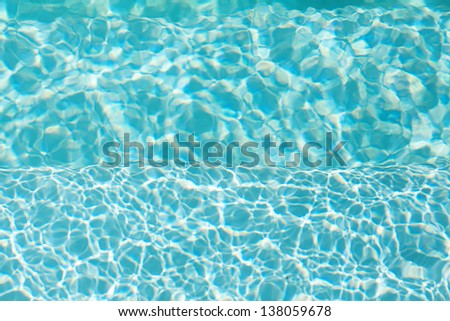 background of the blue swimming pool - stock photo