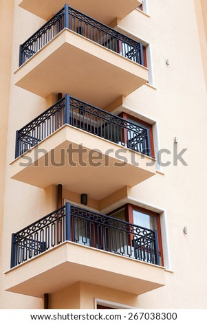 Background of the facade of a residential building, the hotel's terraces - stock photo