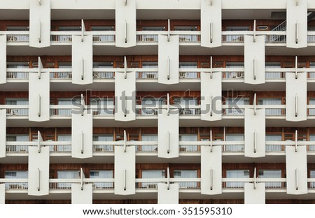 Background of the facade. Repeating pattern of windows and balcony. Building front. - stock photo