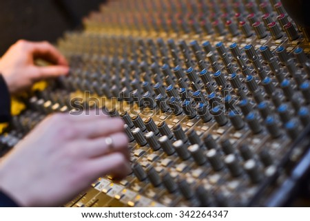 Background of the hands of a DJ while working on professional audio musical mixer, Equipment Digital Voice Recorder