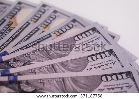 background of the money, background of new hundred dollar bills front side. the evolution of the bill in one hundred dollars, dollars currency isolated on white, fan from american dollars banknotes  - stock photo
