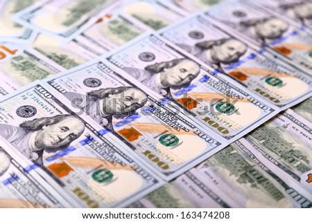Background of the new U.S. hundred-dollar bills put into circulation in October 2013. Selective focus - stock photo