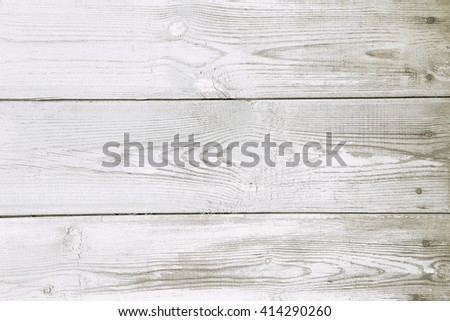 Background of the old wooden horizontal boards with peeling white paint, texture - stock photo