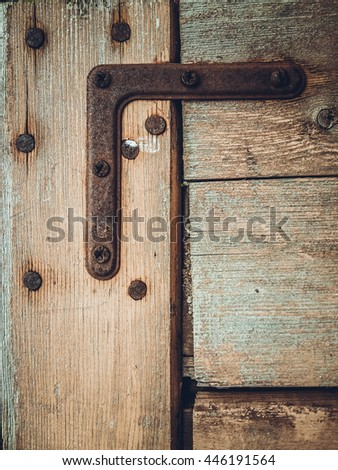 Background of the planks rusty fasteners corner and nails