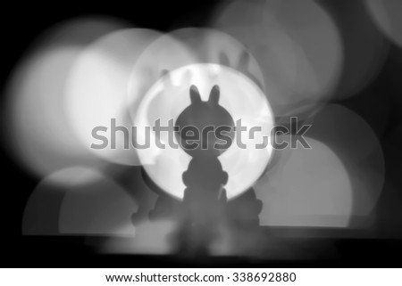 Background of the shadow rabbit with colour light (black and white)
