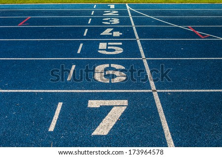 background of the start line of blue running tracks