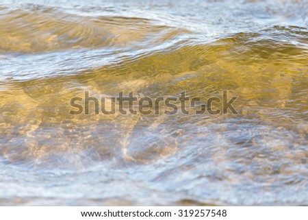 Background of the surface water on the shore - stock photo