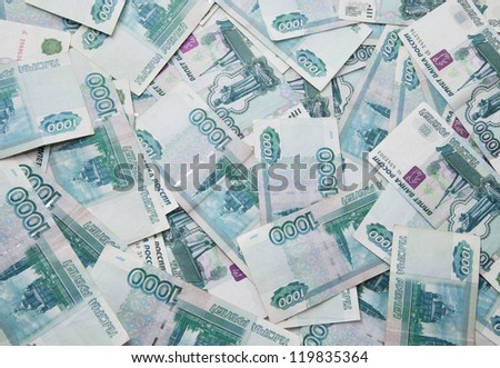 Background of thousand russian roubles bills, close-up - stock photo
