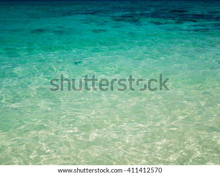 Background of transparent crystal blue sea water surface in summer.  - stock photo