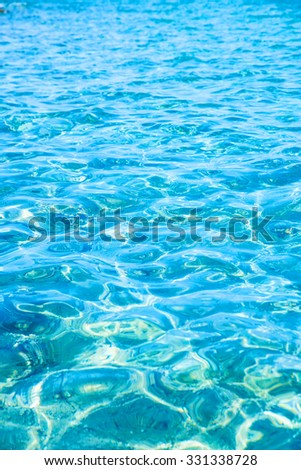 Background of transparent ocean water ripples. - stock photo