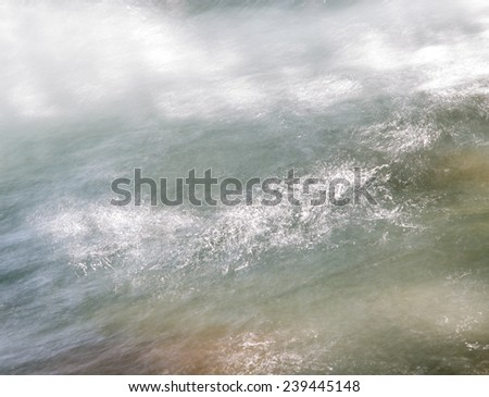 background of turbulent water in the mountain river - stock photo