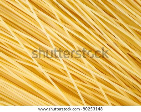 Background of uncooked italian spaghetti - stock photo