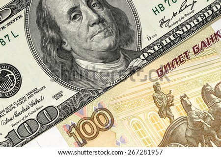 background of US dollars and Russian rubles