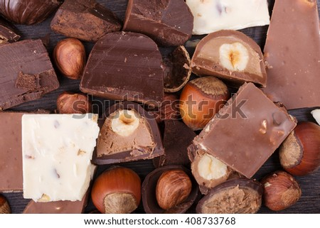 background of various chocolate with hazelnuts
